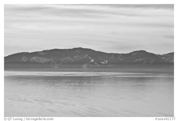 Distant mountains on lake rim in winter, Lake Tahoe, Nevada. USA (black and white)