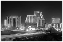Illuminated casinos and freeway at night. Reno, Nevada, USA (black and white)