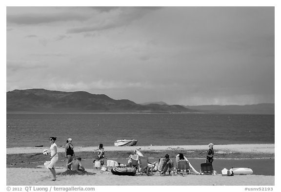 Lakeshore beach recreation, approaching storm. Pyramid Lake, Nevada, USA (black and white)