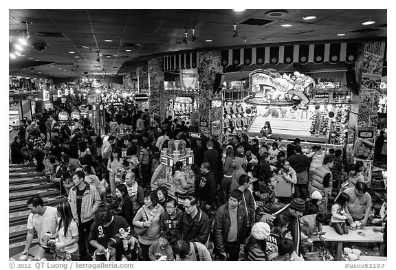 Crowded carnival game area. Reno, Nevada, USA (black and white)