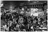 Crowded carnival game area. Reno, Nevada, USA ( black and white)