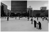 Skaters on holiday ice rink. Reno, Nevada, USA (black and white)