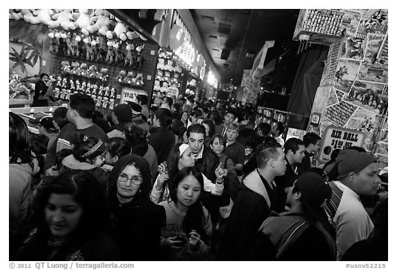 Densely packed crowds in circus arcade. Reno, Nevada, USA (black and white)