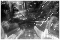 Fast moving lights and arcade game players. Reno, Nevada, USA (black and white)