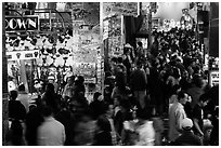 Holiday crowds in carnival game area. Reno, Nevada, USA (black and white)