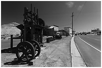 Historic mining equipement lining main street. Nevada, USA (black and white)