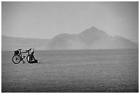 Bicyclist on the desert Playa, Black Rock Desert. Nevada, USA (black and white)