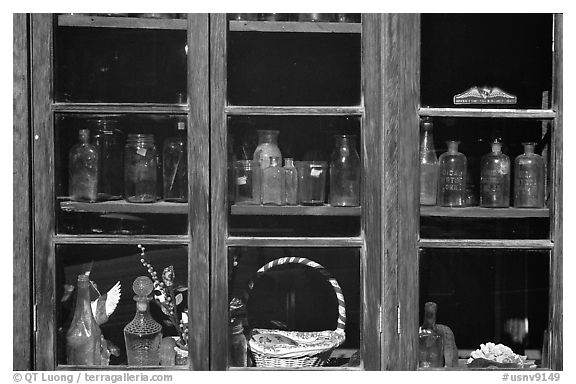 Old bottles in a store window, Austin. Nevada, USA (black and white)