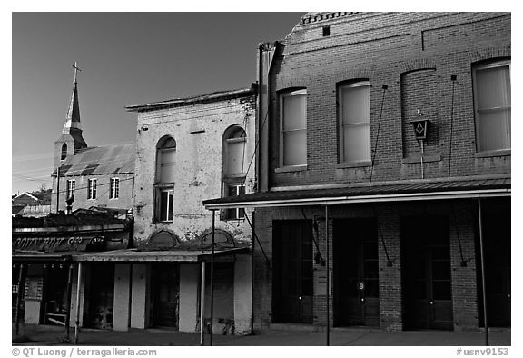 Buildings on main street and church, sunset, Austin. Nevada, USA (black and white)