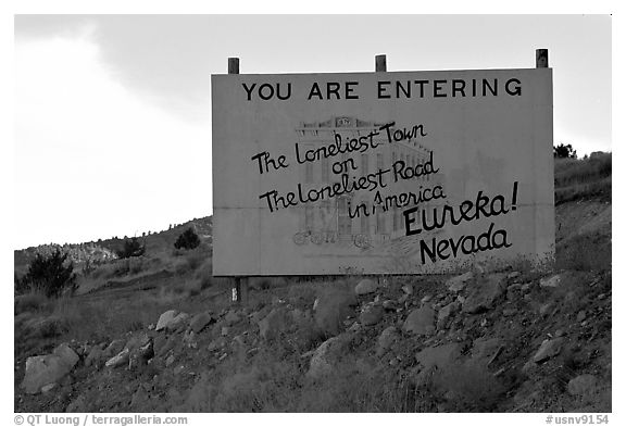 Loneliest town on the loneliest road sign. Nevada, USA (black and white)