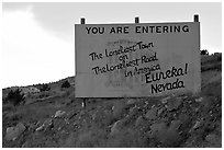 Loneliest town on the loneliest road sign. Nevada, USA ( black and white)