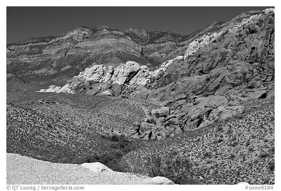 Red sandstone formations, and green hills, Red Rock Canyon. Red Rock Canyon, Nevada, USA (black and white)