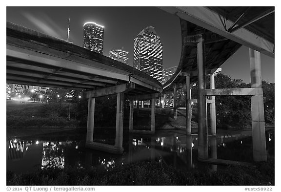 Skyline from under highway bridges at night. Houston, Texas, USA (black and white)