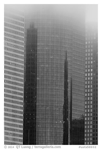Top of skyscrapers capped by fog. Houston, Texas, USA (black and white)