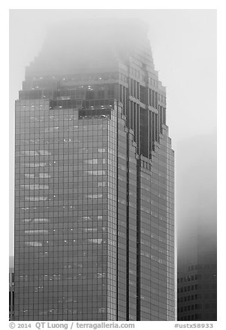 Top of skyscrapers capped in clouds. Houston, Texas, USA (black and white)