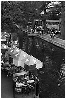 Restaurant tables under Texas flag umbrellas. San Antonio, Texas, USA ( black and white)