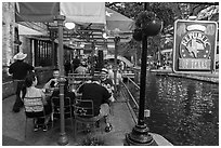 Republic of Texas restaurant on Riverwalk. San Antonio, Texas, USA ( black and white)