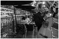 Musician on Riverwalk. San Antonio, Texas, USA ( black and white)