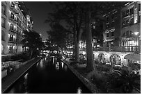 Residences and restaurants, Riverwalk at night. San Antonio, Texas, USA ( black and white)