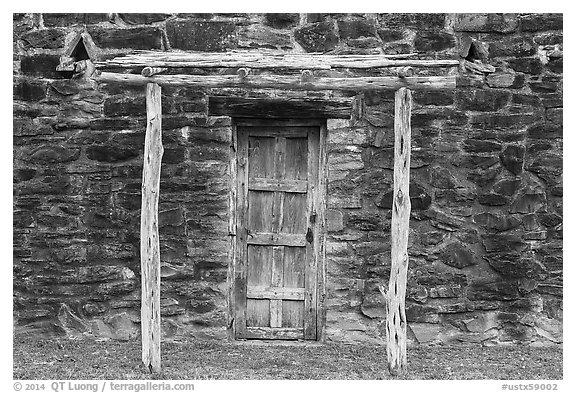 Door in wall, Indian quarters, Mission San Jose. San Antonio, Texas, USA (black and white)