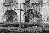 Cross in courtyard, Mission San Jose. San Antonio, Texas, USA ( black and white)