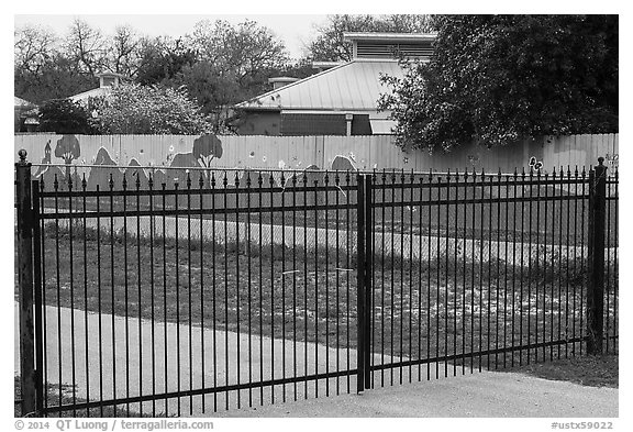 Fence with landscape mural decor. San Antonio, Texas, USA (black and white)