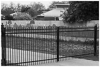 Fence with landscape mural decor. San Antonio, Texas, USA ( black and white)