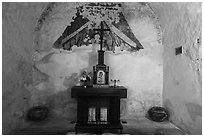 Secondary altar in adobe room, Mission Concepcion. San Antonio, Texas, USA ( black and white)