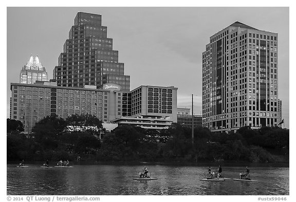 Water pedaling in front of skyline at dusk. Austin, Texas, USA (black and white)