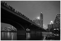 Watching one million bats fly at dusk. Austin, Texas, USA ( black and white)