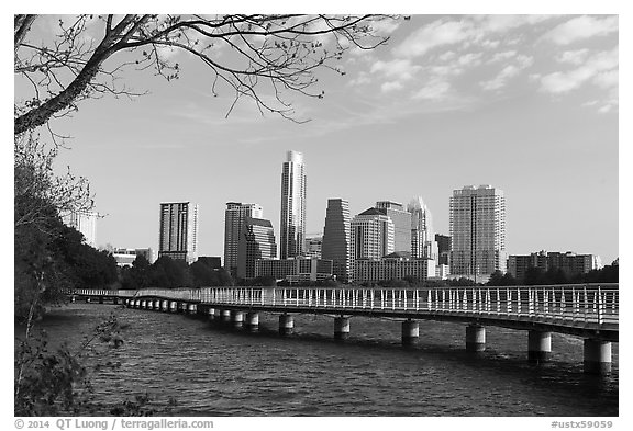 Skyline and pier over Colorado River. Austin, Texas, USA (black and white)