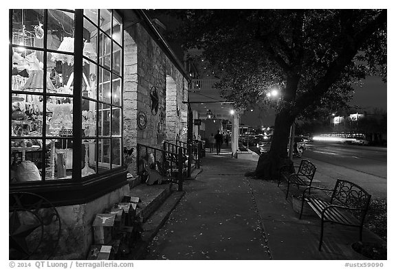 Sidewalk and stores at dusk. Fredericksburg, Texas, USA (black and white)