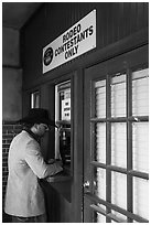 Man registers as rodeo contestant, Stockyards. Fort Worth, Texas, USA ( black and white)