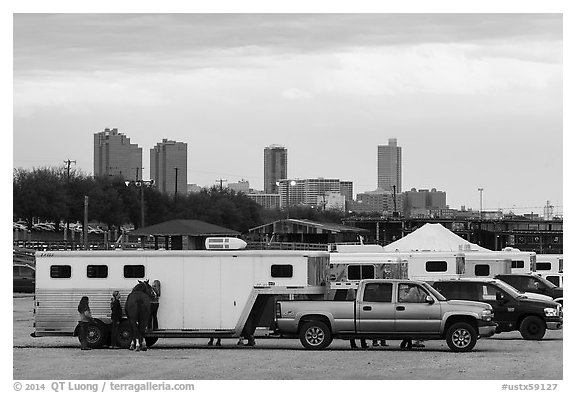 Trucks with horse trailers and skyline. Fort Worth, Texas, USA (black and white)