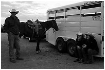 Group talking next to horse and trailer. Fort Worth, Texas, USA ( black and white)