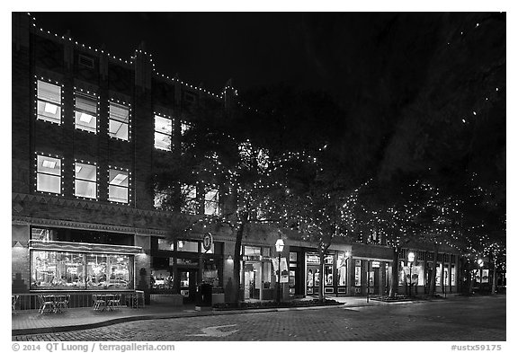 Street at night with lighted stores. Fort Worth, Texas, USA (black and white)