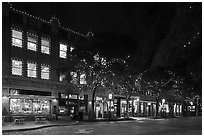 Street at night with lighted stores. Fort Worth, Texas, USA ( black and white)
