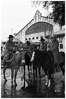 Cowboys in raincoats in front of Cowtown coliseum. Fort Worth, Texas, USA ( black and white)