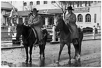 Cowboys in raincoats. Fort Worth, Texas, USA ( black and white)
