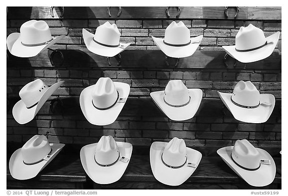 Light cowboy hats for sale. Fort Worth, Texas, USA (black and white)
