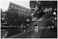 Elm Street with X marking JFK assassination spot and Texas School Book Depository,. Dallas, Texas, USA ( black and white)