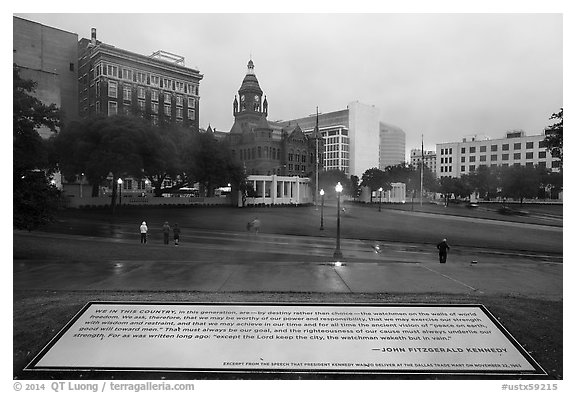 Sign commemorating JFK on assassination site. Dallas, Texas, USA (black and white)