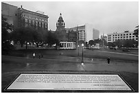 Sign commemorating JFK on assassination site. Dallas, Texas, USA ( black and white)