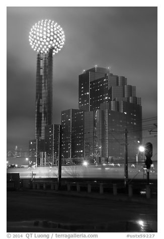 Reunion Tower and passing train at night. Dallas, Texas, USA (black and white)