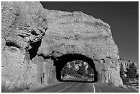 Road tunnel in pink limestone cliff. Utah, USA (black and white)