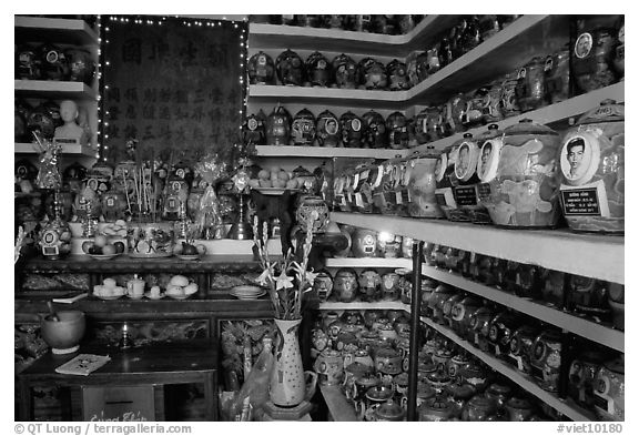 Temple room containing funeral urns with ashes of the deceased. Ho Chi Minh City, Vietnam (black and white)