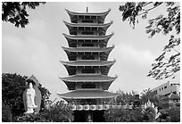Eight-story tower of Vinh Ngiem pagoda, District 3. Ho Chi Minh City, Vietnam (black and white)