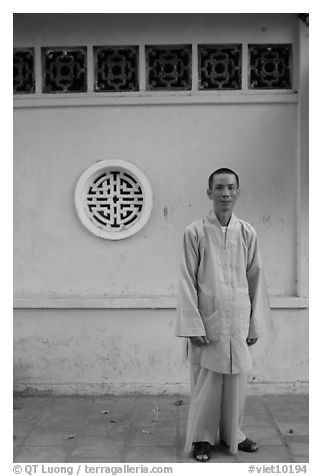 Monk standing outside Giac Vien Pagoda, district 11. Ho Chi Minh City, Vietnam (black and white)