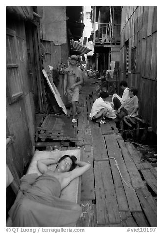 Sleeping late in a narrow alley. Ho Chi Minh City, Vietnam (black and white)