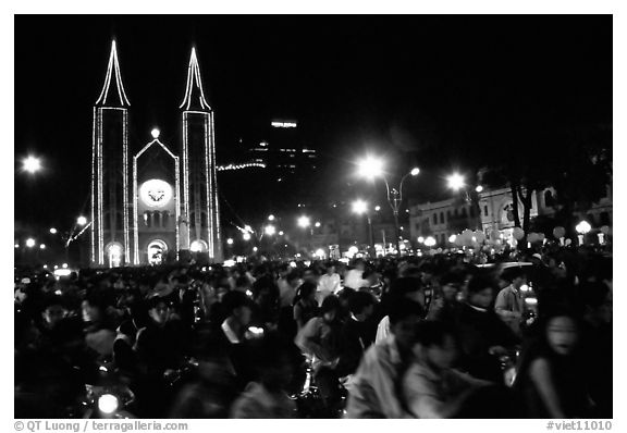 Crowds gather in front of the Cathedral St Joseph for Christmans. Ho Chi Minh City, Vietnam (black and white)